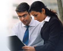 Businessman and businesswoman looking at a computer